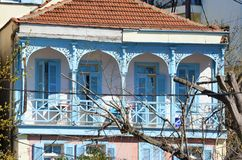 Greek House with Blue  Windows and Shutters. And Balcony Royalty Free Stock Photo