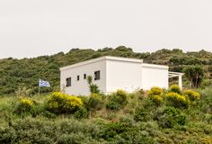 Greek house on a hill Stock Photography