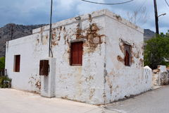 Greek House - old and small. Old and small greek house. White walls and brown shutters Stock Images