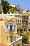 Greek houses. Colorful houses creeping up the hillside on Symi island, Greece royalty free stock photo