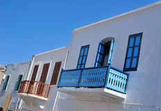 Greek houses with colorful windows Royalty Free Stock Images