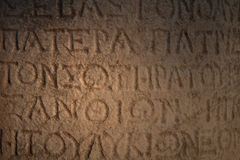 A Greek inscription carved in stone. At ancient ruins Stock Photos