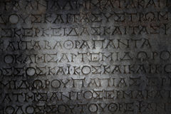 A Greek inscription carved in stone. At ancient ruins Stock Photo