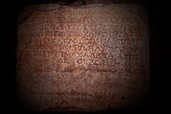 A Greek inscription carved in stone. At ancient ruins Royalty Free Stock Photos