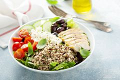 Greek inspired lunch bowl with chicken and quinoa. Greek inspired lunch bowl with chicken, quinoa, feta cheese and olives royalty free stock photography