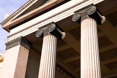 Greek Ionic Column. A detail of an old building built in the old Greek style with Ionic columns stock photography