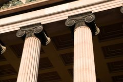 Greek Ionic Column. A detail of an old building built in the old Greek style with Ionic columns royalty free stock photo