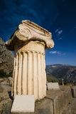 Greek Ionic column with capital. Found in the ancient city of Delphi, Greece royalty free stock photo