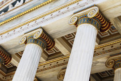 Greek ionic columns and ceiling. Details of Greek ionic orders columns and the ceiling of an ancient monument Stock Photography