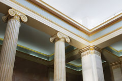 Greek ionic columns and ceiling inside museum. Details of Greek ionic columns and the ceiling of a museum room royalty free stock photo