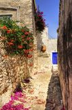 Greek island alley. A picturesque alley on the Greek island Hydra Royalty Free Stock Photography