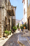 Greek island alley. A picturesque alley on the Greek island Hydra, which depicts some of the local architecture Royalty Free Stock Images
