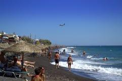 Greek island beach vacationers Royalty Free Stock Image