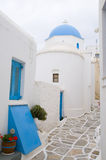 Greek island church lefkes paros cyclades greece. Classic greek island blue dome church in painted tile alley lefkes village paros cyclades in greece Royalty Free Stock Photos