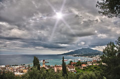 Greek island with cloudy sky Stock Photos