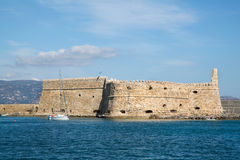 Greek island crete in the cyclades: sightseeing on the old port Royalty Free Stock Images