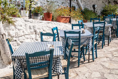 Greek island dining tables Royalty Free Stock Photo