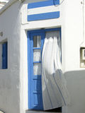 Greek Island doorway with curtain Kimilos Greece Stock Photo