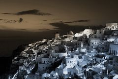Greek Cityscape of Buildings at Dusk in the town of Oia, Santorini, Greece stock images