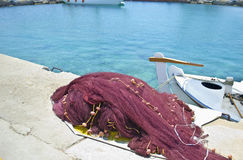 Greek island fishing nets and a boat Royalty Free Stock Photos