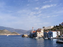 Greek Island of Kastellorizo. The main harbour of the tiny Greek island of Kastellorizo in the winter sunshine. The Turkish coast is in the distance Stock Photos