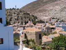 The Greek Island of Kastellorizo/Meyisti. Colourful houses, shops, tavernas and church surround the waterfront of the Greek island of Kastellorizo or Meyisti stock photography