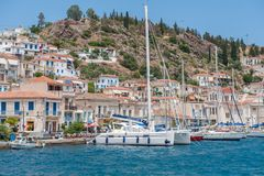 Greek island Poros. Poros, Greece - May 30, 2009: Poros on a sunny day. Poros is a small Greek island in the Aegean sea belonging to the Saronic islands Royalty Free Stock Images