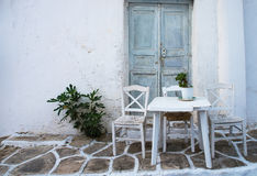 Greek island restaurants. With colorful tables and chairs stock photo