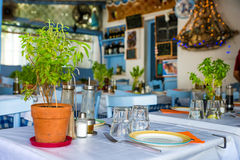 Greek island. Restaurants with colorful tables and chairs stock images