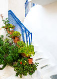 Greek island restaurants. Greek island street with colorful shutters and doors Royalty Free Stock Photo
