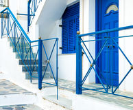 Greek island. Street with colorful shutters and doors Royalty Free Stock Photo