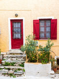 Greek island. Street with colorful shutters and doors Royalty Free Stock Image