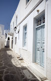 Greek island street scene. Cyclades architecture  tile road painted Royalty Free Stock Image