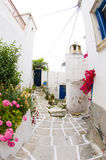 Greek island street scene and classic architecture. Cyclades greek island street scene with white washed classic architecture and painted tile streets with Stock Image