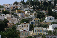 The Greek island of Symi. SYMI, GREECE - JULY , 6 : The colorful village houses in the Greek island of Symi on July 6 , 2006 in Symi, Greece Royalty Free Stock Photography