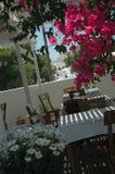 Greek island taverna. Restaurant with flowers royalty free stock photography
