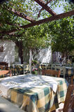 Greek island taverna restaurant in garden Royalty Free Stock Photography