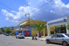 Greek island town street view. Main commercial street in Nydri,bank in the foreground,Lefkada island,Greece. Nydri is a popular summer resort town Royalty Free Stock Photography
