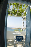 Greek island view from motel. Greek island view from guest house with grape arbor and classic stone patio Stock Photography
