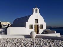 Greek Islands Style Beautiful White Church against Sunny Blue Sky, Oia Village, Santorini Island, Greece stock photo
