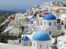 Greek Islands Style White and Blue Colored Churches at Oia Village, Santorini. Island of Greece Royalty Free Stock Images