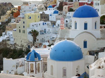 Greek Islands traditional white and blue churches and architecture at Oia village, Santorini island Stock Photography