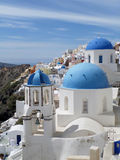 Greek Islands traditional white and blue churches at Oia village on Santorini island Royalty Free Stock Image