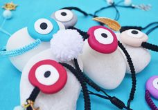 Greek jewelry - evil eye bracelets on white stones Stock Image