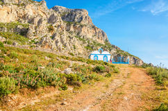 Greek landscape, hills, blue and white church Stock Photos