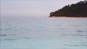 Greek landscape - Thassos island, Marble beach, Aegean sea. Silent waves. Greek landscape - Thassos island, Saliara beach (Marble beach), Aegean sea. Silent stock footage