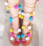 Greek leather sandals with colorful pom pom and evil eye Royalty Free Stock Photography