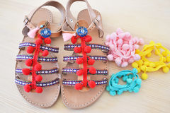 Greek leather sandals with colorful pom pom Stock Images