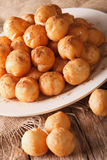 Greek loukoumades donuts with honey and cinnamon closeup.  Royalty Free Stock Photography