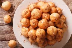 Greek loukoumades donuts with honey and cinnamon closeup. Horizo Stock Images